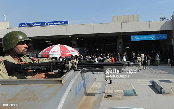 A Pakistani paramilitary soldier stands guard outside the International departure lounge of the Benazir Bhutto International Airport during a strike...