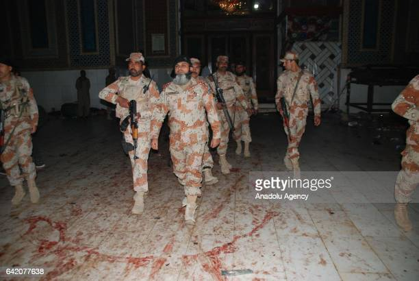 Pakistani paramilitary soldiers arrive at the site of a suicide attack at the 13th century old shrine of a Muslim saint in the town of Sehwan in...