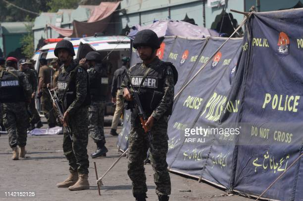 Pakistani paramilitary soldiers cordon off the site of a bomb blast outside a Sufi shrine in Lahore on May 8, 2019. - A blast at one of Pakistan's...