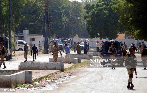 Pakistani paramilitary soldiers gather around the site of a suicide bomb attack near Rangers' checkpost in Karachi January 29 2014 Three bomb blasts...