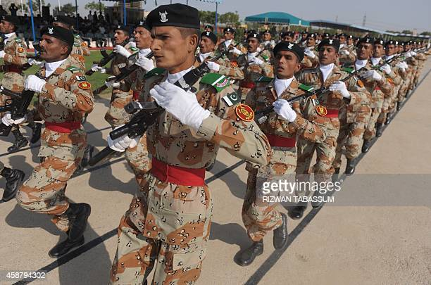Pakistani paramilitary soldiers march during the 18th passing out parade for the Rangers basic recruits training course at the Sindh Rangers Training...