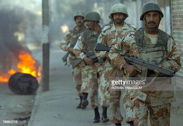Pakistani paramilitary soldiers patrol a street of Karachi 28 December 2007 a day after former Prime Minister Benazir Bhutto was killed in a suicide...