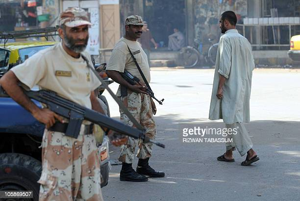 Pakistani paramilitary soldiers stand guard on a street in Karachi on October 21 2010 Police and paramilitary units stepped up patrols on October 21...