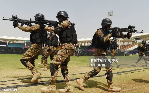 Pakistani paramilitary soldiers take part in a drill exercise at the National Cricket Stadium in Karachi on March 7 ahead of the Pakistan Super...
