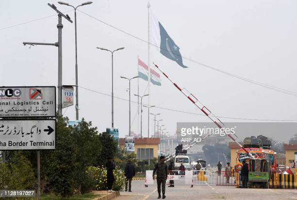 Pakistani paramilitary soldiers walk at a check post near the India and Pakistan border on the Pakistani side of the Wagah border on March 1 2019...