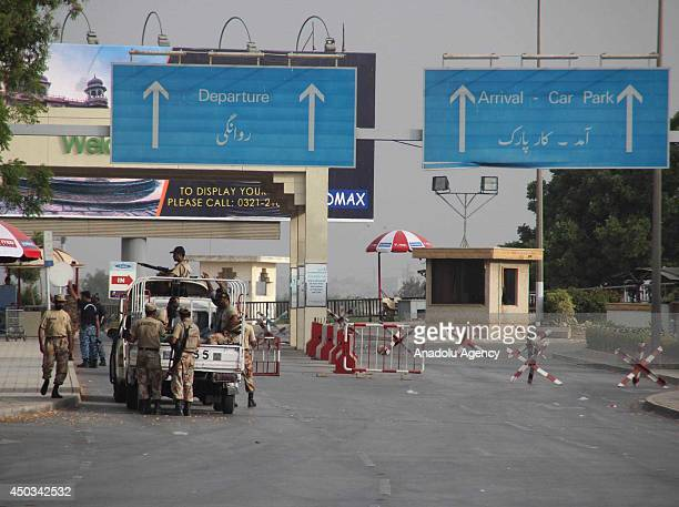 Pakistani paramilitry soldiers stand guard after armed attack on Jinnah international airport in Karachi Pakistan on June 09 2014 Death toll rises to...