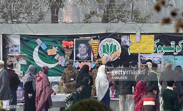 Pakistani parents gather at the Army Public School with their children after it was reopened following an attack there by Taliban militants in...