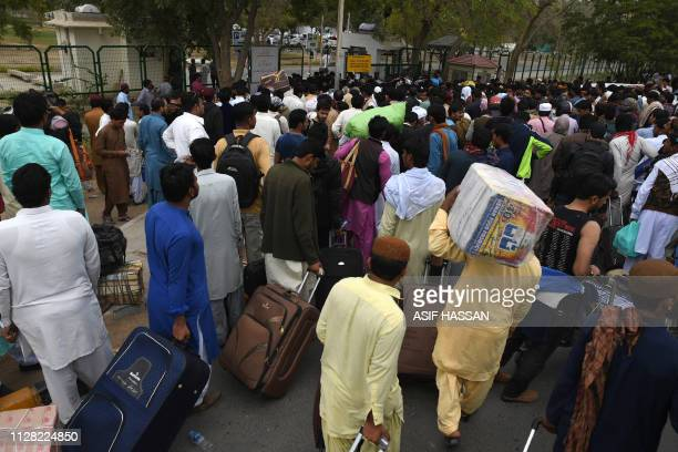 Pakistani passengers gather outside the Jinnah International Airport as they wait for flight operations to resume in Karachi on March 1 2019 Pakistan...