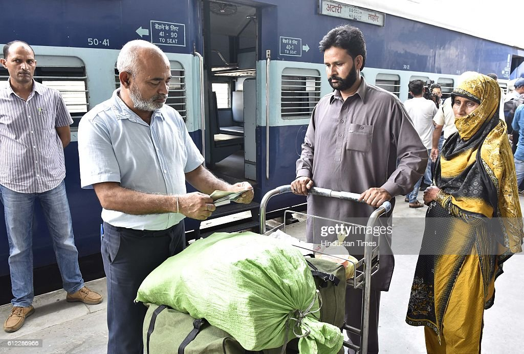 Pakistani passengers of Samjhauta Express train coming from Lahore stand in a queue for custom check after the arrival at Attari Border Railway...