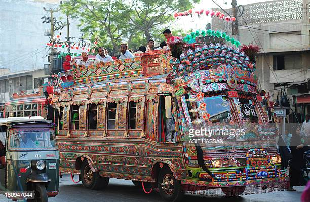 Pakistani passengers travel on a decorated mini passenger bus in Karachi on September 18 2013 Bus art has been very much in vogue in this port city...
