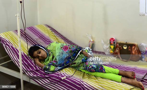 A Pakistani patient suffering from thalassemia receives a blood transfusion during treatment on World Thalassemia Day in Peshawar on May 8 2018...