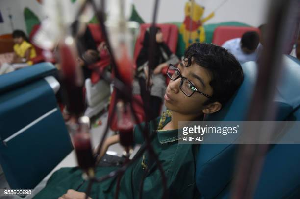 A Pakistani patient suffering from thalassemia receives blood transfusion during treatment to mark the World Thalassemia Day in Lahore on May 7 2018...