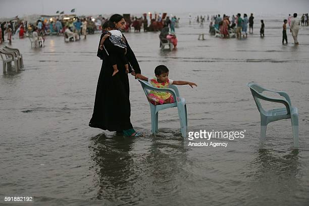 Pakistani people bathe in the sea to become cool at Clifton beach in Karachi Pakistan on August 18 2016