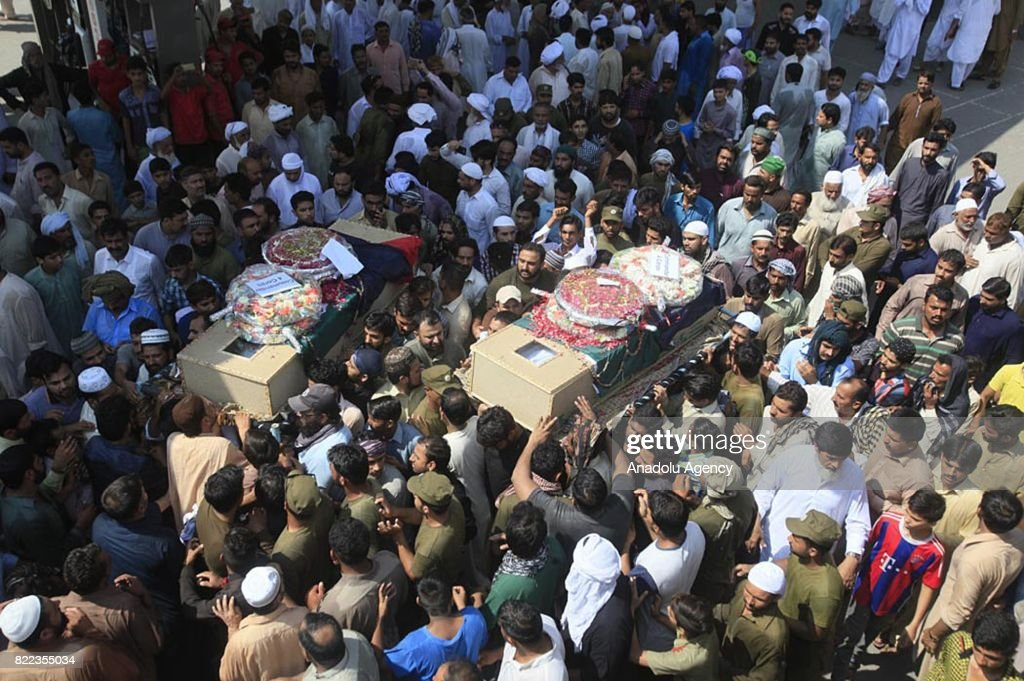 Pakistani people carry the coffins of blast victims during the funeral ceremony after a suicide bomb attack in Lahore Pakistan on July 25 2017 An...