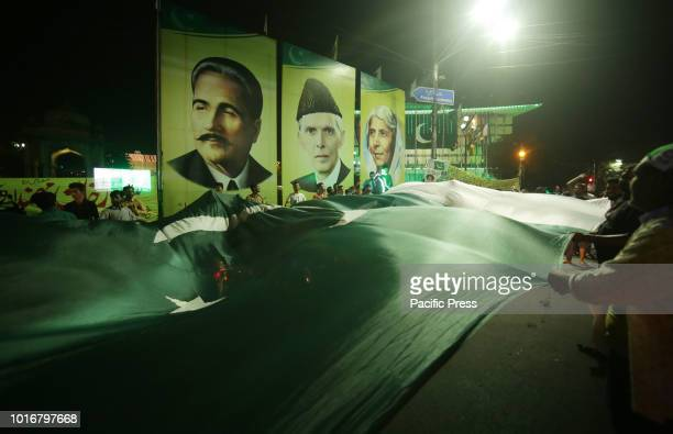 Pakistani people celebrate 71st Independence day at midnight on mall road in Lahore Streets nationwide brimmed with green and white decorations...