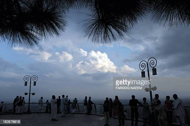Pakistani people enjoy the capital view at a hill point in Islamabad on March 27 2009 Afghanistan and Pakistan welcomed President Barack Obama's new...