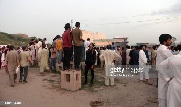Pakistani people gather at the site of plane crash an Rawalpindi, Pakistan on July 30, 2019. Fifteen people were killed when a Pakistan Aviation...