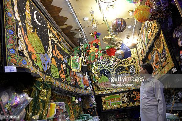 Pakistani people go for a shopping ahead of the 1445th anniversary for the celebration of Mawlid alNabi marking the birth of the Prophet Muhammad in...