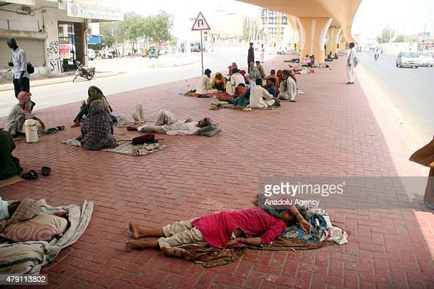 Pakistani people rest under a bridge during a heatwave in Karachi Pakistan July 01 2015 Nearly twothirds of the victims of a killer heatwave that...
