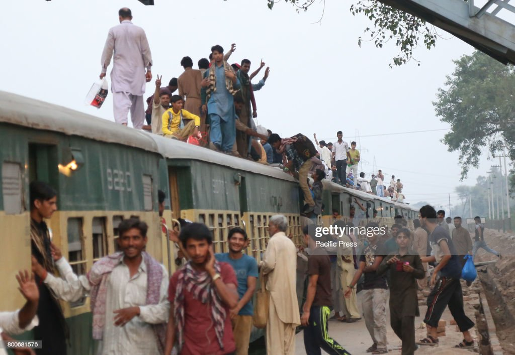Pakistani people rode on top of a train at Shahdara Railway Station to reach their home town back to celebrate Eid alFitr with their love ones in...