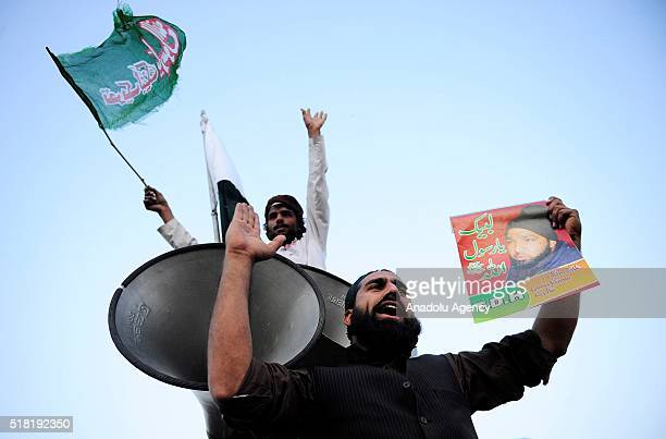 Pakistani people stage a protest against the execution of Mumtaz Qadri, former police bodyguard who shot dead Punjab's governor Salman Taseer in...