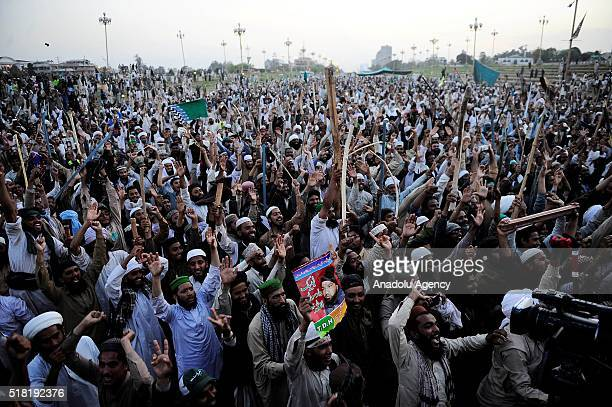 Pakistani people stage a protest against the execution of Mumtaz Qadri former police bodyguard who shot dead Punjab's governor Salman Taseer in...