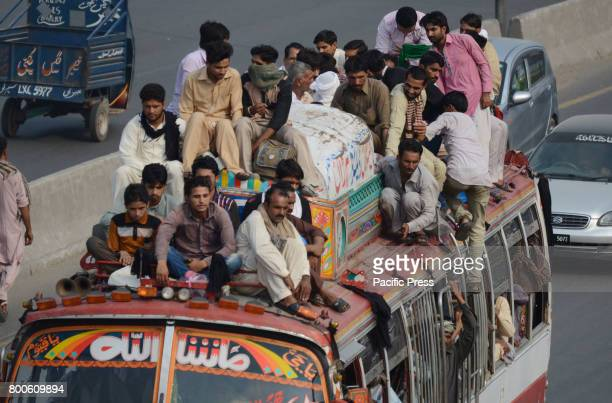 Pakistani people travel by overcrowded bus going back to their hometowns before Eid alFitr festival Muslims around the world are preparing to...