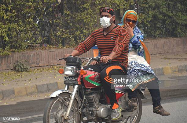 Pakistani people using mask to protect him during 2nd day of smog engulf. Pakistani residents and commuters are more worried than surprised due to...
