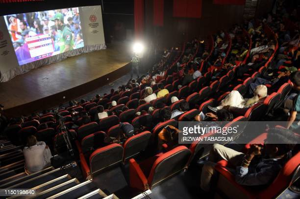 TOPSHOT Pakistani people watch a live broadcast of the 2019 Cricket World Cup match between Pakistan and India in a theatre in Karachi on June 16 2019