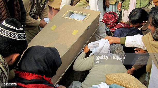 Pakistani peoples bury a Frontier Constable who was killed in twin bombings in Quetta during the funeral ceremony in Mianwali on January 12 2013 FC...