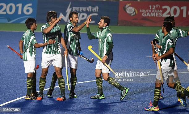 Pakistani players celebrate their second goal against Sri Lanka during their hockey match at the 12th South Asian Games 2016 in Guwahati on February...