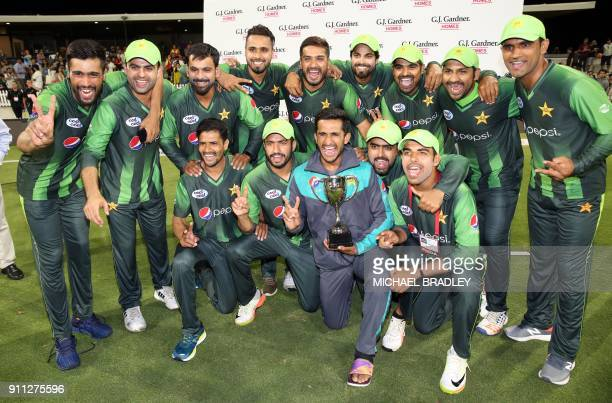 Pakistani players celebrate winning the series after the third Twenty20 international cricket match between New Zealand and Pakistan at Bay Oval in...