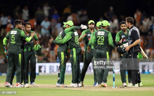 Pakistani players celebrate winning the third Twenty20 international cricket match between New Zealand and Pakistan at Bay Oval in Mount Maunganui on...