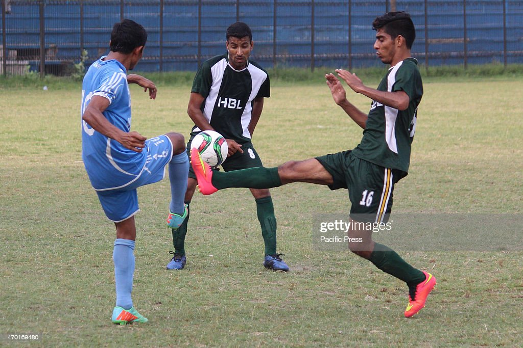 Pakistani players of HBL PAF football teams struggling to get hold on the ball during the National Bank Football Challenge Cup 2015 at railway...