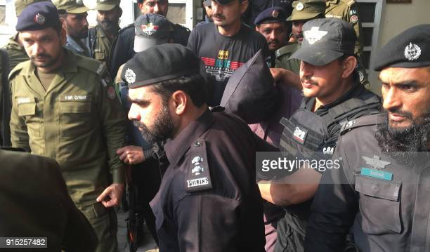 Pakistani police and commandos escort a suspect who is accused of raping and murdering a young girl as they leave an antiterrorist court in Lahore on...