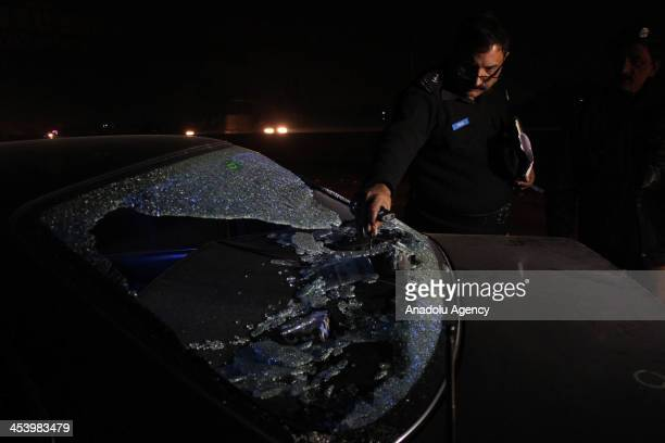 Pakistani police collect the evidence after gunmen attack on vehicle of Sunni Muslim Leader ShamsurRehman Muawiya chief of the Ahle Sunaat Wal Jamaat...