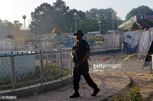 A Pakistani police commando stands guard at the site following an overnight suicide bombing in Lahore on March 28 2016 The toll from a suicide blast...