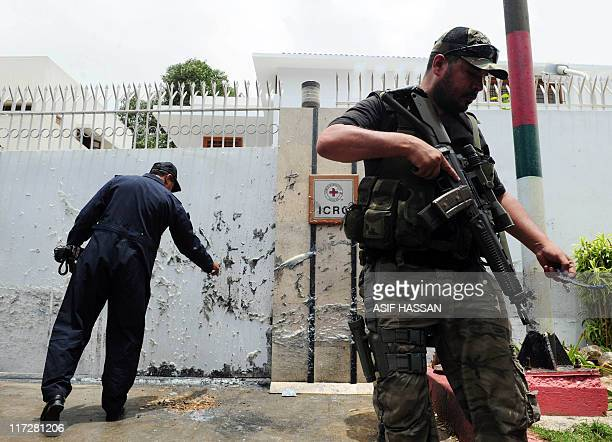 A Pakistani police commando stands guard outside the International Committee of Red Cross in Karachi on June 25 2011 A bomb failed to explode outside...