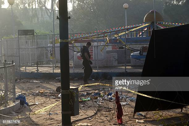 A Pakistani police commando walks at the cordonedoff site of the March 27 suicide bombing in Lahore on March 28 2016 The toll from a suicide blast in...