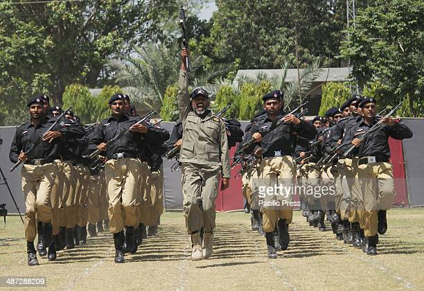 Pakistani Police commandos display their skills during a passing out parade upon the completion of their threemonth training at the Ranger...