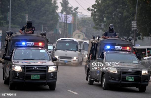 Pakistani police commandos escort the buses of the Sri Lankan and Pakistani cricket teams as they arrive at the Gaddafi Cricket Stadium in Lahore on...