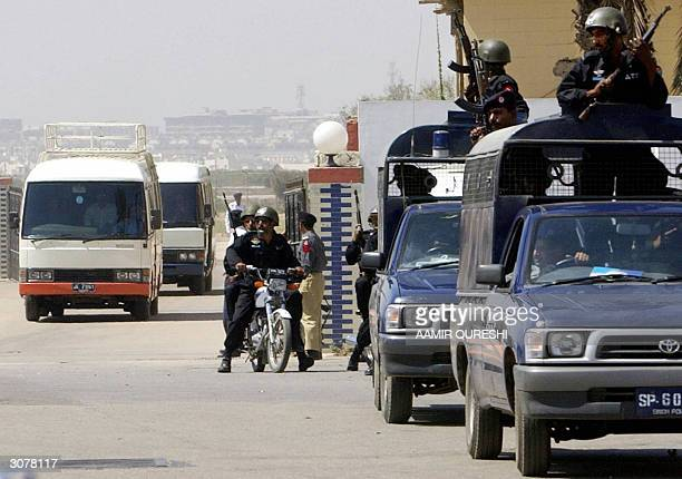 Pakistani police commandos escort the Indian team convoy to their hotel after their arrival at Karachi International Airport 12 March 2004 as part of...