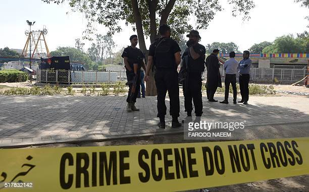 Pakistani police commandos stand guard at the suicide blast site in Lahore on March 28 2016 A suicide bomber who attacked a park thronging with...