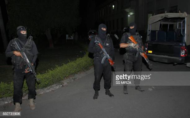 Pakistani police commandos stand guard outside a morgue of a hospital in Multan on May 19 where eight bodies of suspected AlQaeda militants were...