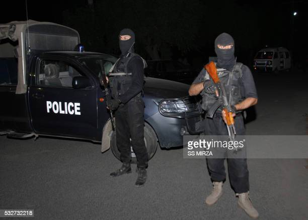 Pakistani police commandos stand guard outside a morgue of a hospital in Multan, on May 19 where eight bodies of suspected Al-Qaeda militants were...
