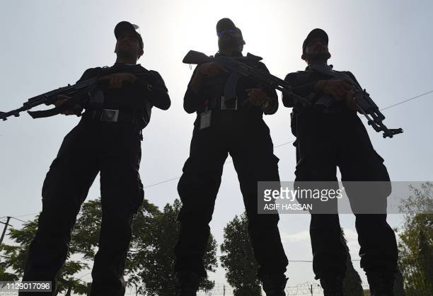 Pakistani police commandos stand guard outside the National Cricket Stadium in Karachi on March 7 ahead of the Pakistan Super League matches Pakistan...