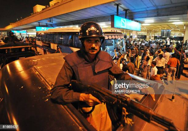 Pakistani police commandos stand on their vehicles as they escort a bus carrying Indian cricketers upon their arrival at the Jinnah International...