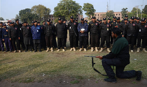 Pakistani police commandos take part in a security drill to fight against militants at police lines A Pakistan university attacked by the Taliban...