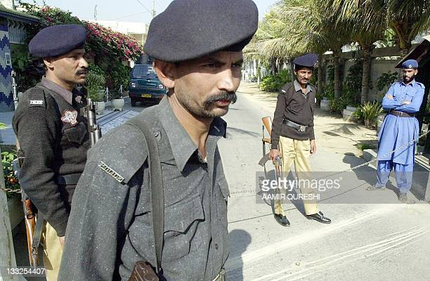 Pakistani police cordon off a street where missing Wall Street Journal correspondent Daniel Pearl was residing before he was abducted in Karachi 31...