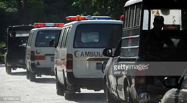 Pakistani police escort an ambulance carrying the coffin of Sarabjit Singh an Indian death row prisoner that was killed to the airport in Lahore on...